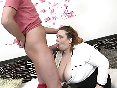 Huge breasted Mature BBW doing her horny toy boy