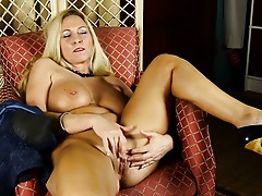 Big breasted American housewife masturbating herself to a orgasm