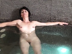 Mature ladies unwinding and getting naked